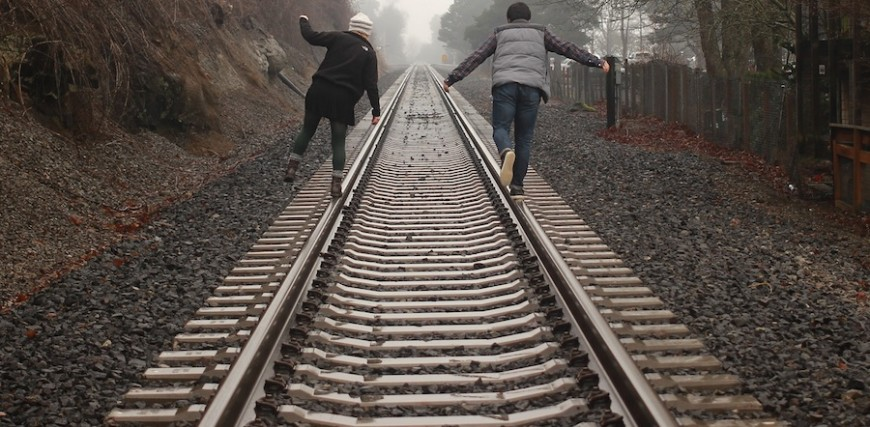 balancing on train tracks