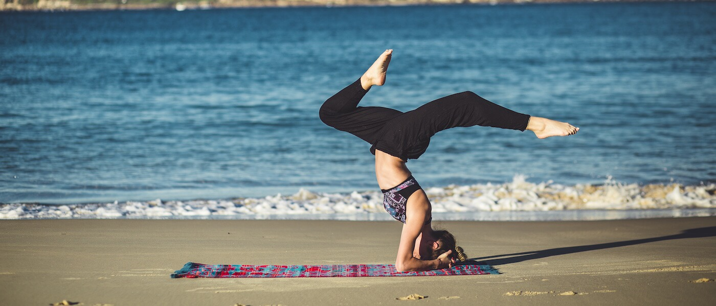 yoga pose on beach