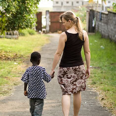 woman and child walking together